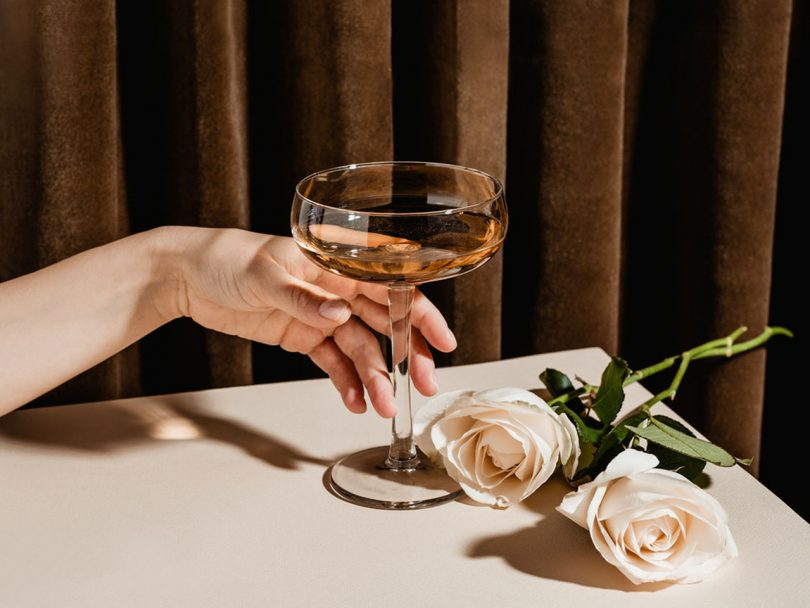 A woman reaches for a cocktail. Women are increasingly drinking themselves into long-term illness and even death