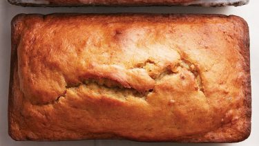 classic banana bread recipe: banana bread loaf on white background