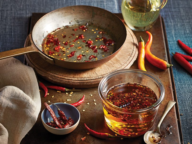 Hot red chili oil in pan and jar