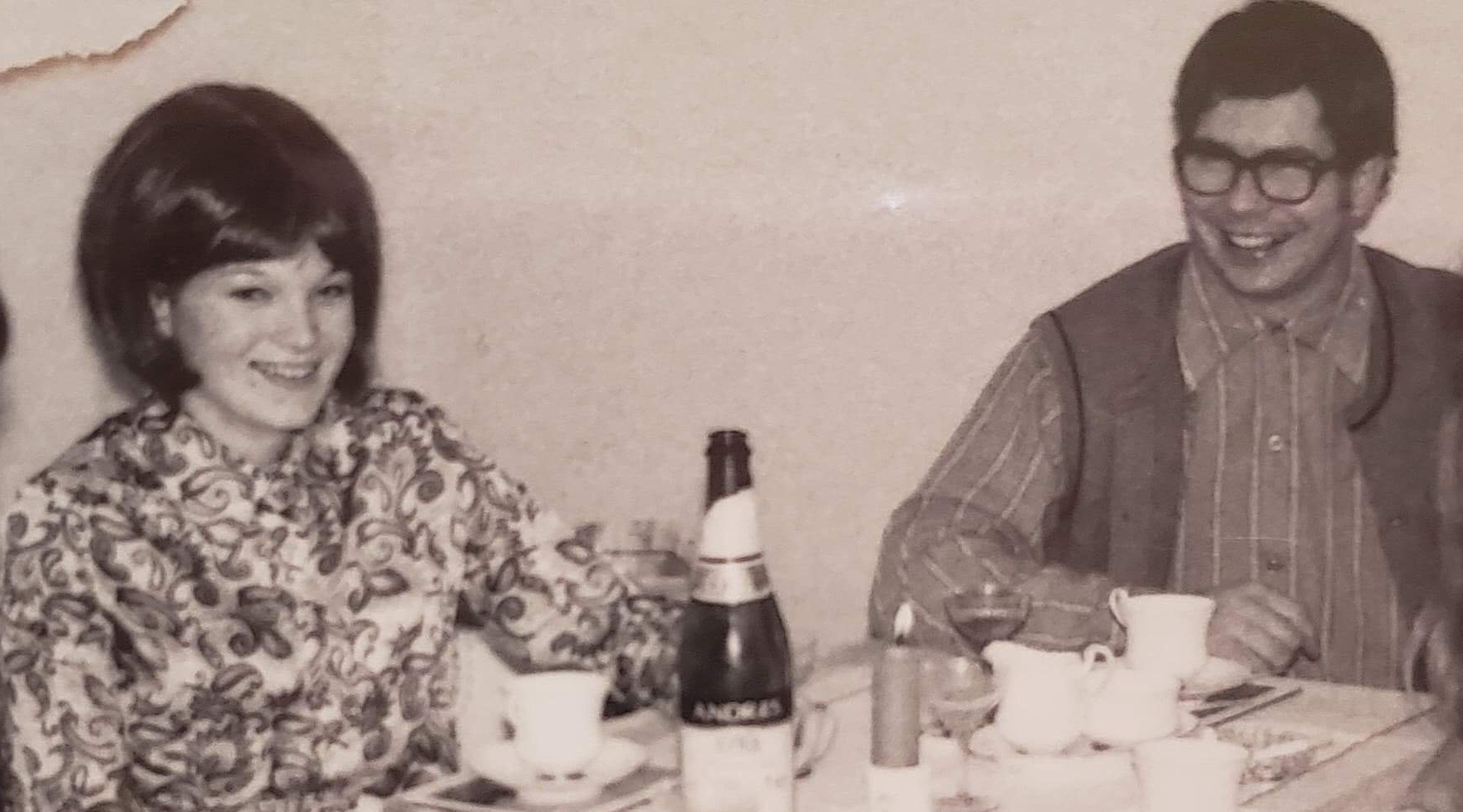 complicated love story- a couple photographed at a table together in 1970