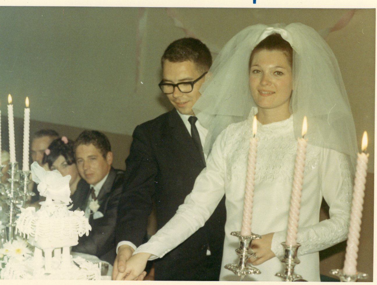 complicated love story-wedding image of a couple cutting a cake
