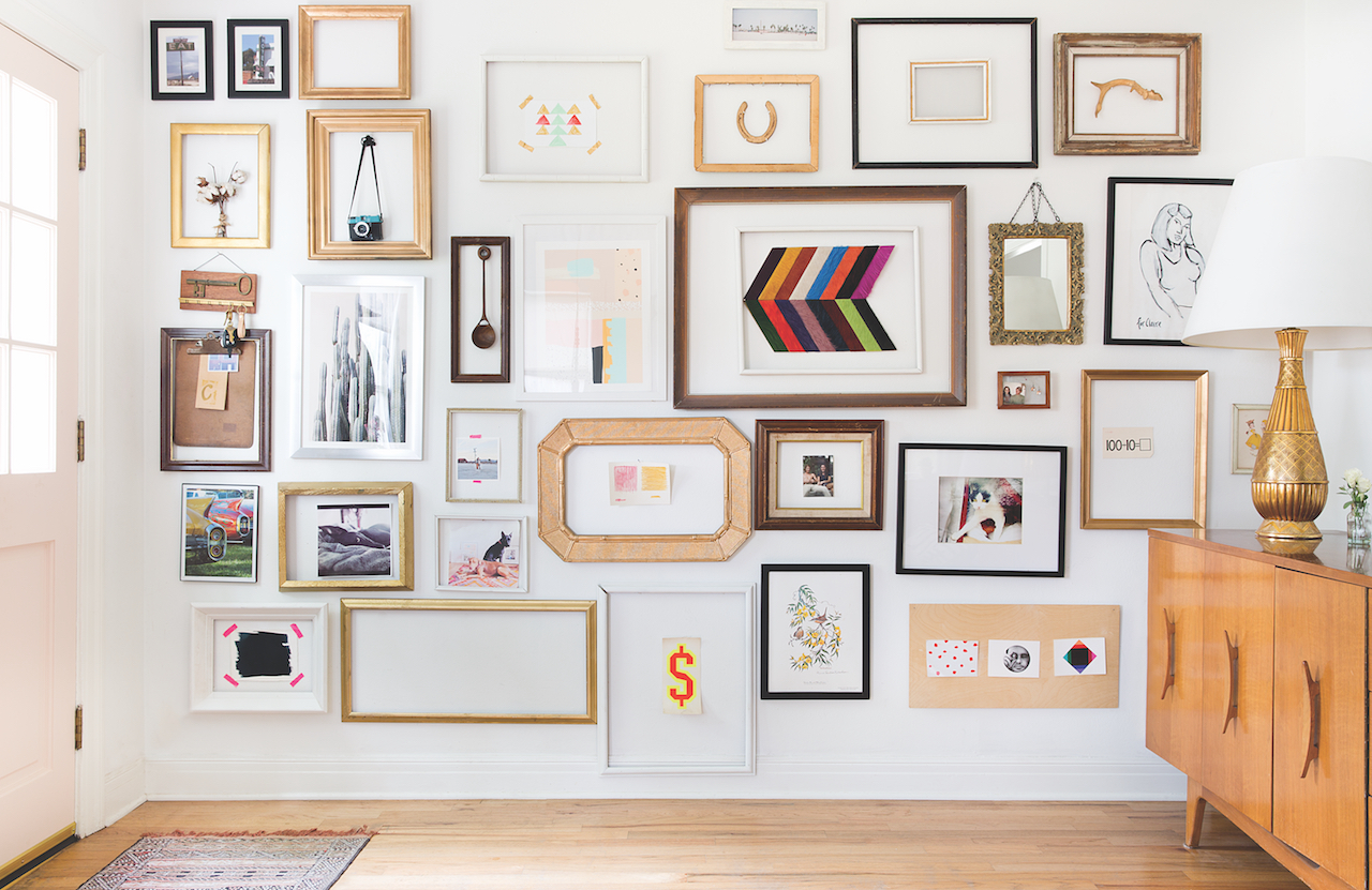 gallery wall-an assortment of framed art on a white wall