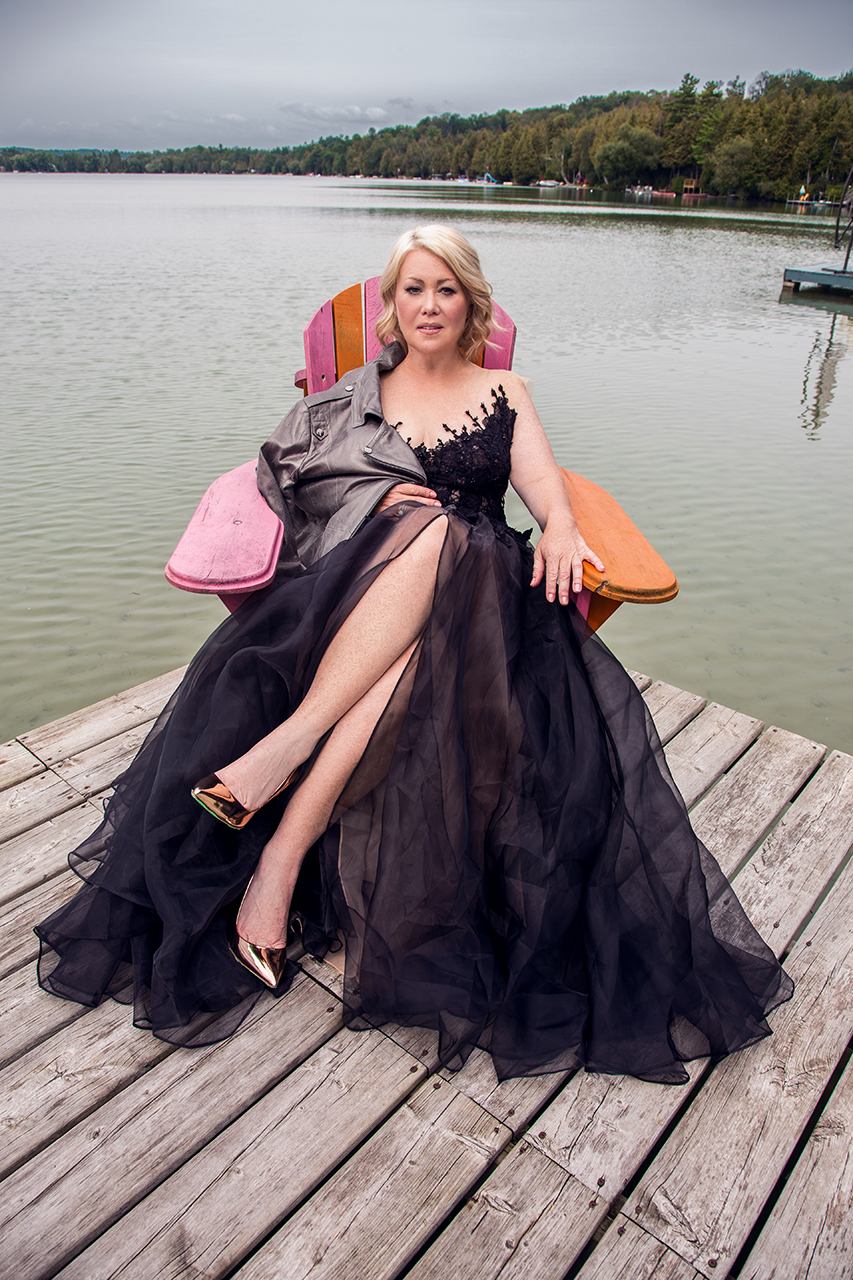 February/March Ms. Chatelaine Jann Arden sits on the dock in a black gown