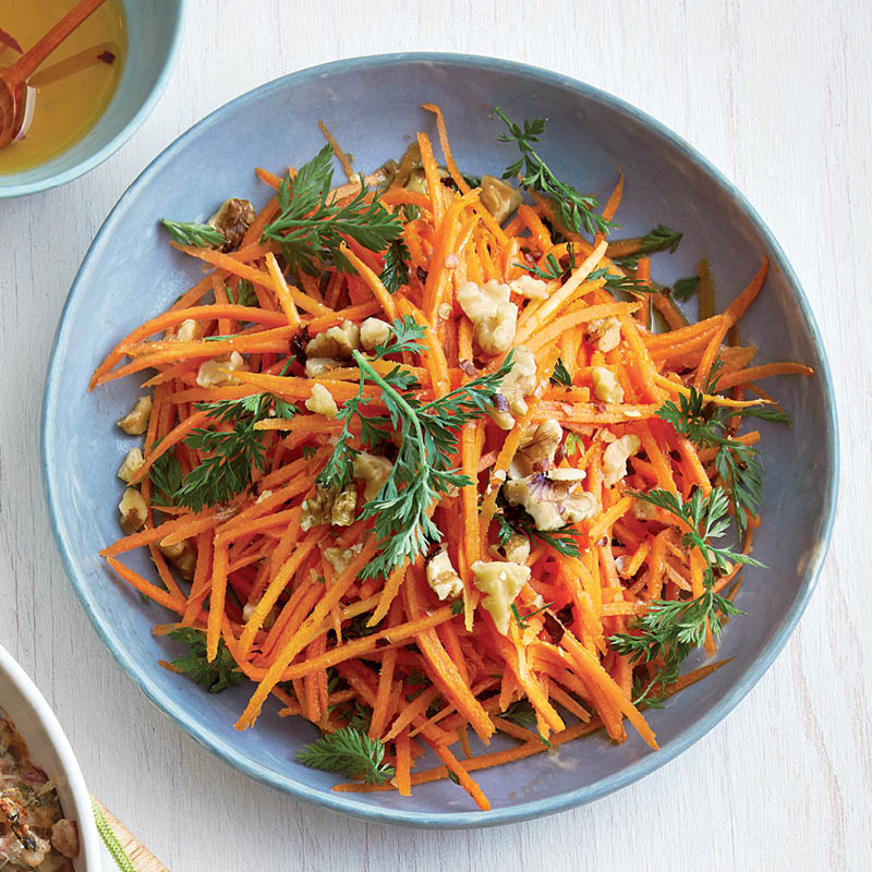 carrot slaw in blue bowl
