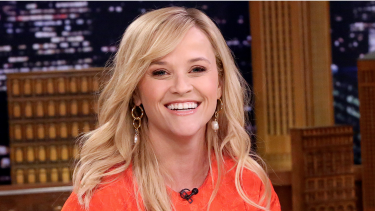 Celebrity Hair-Reese Witherspoon wearing an orange shirt