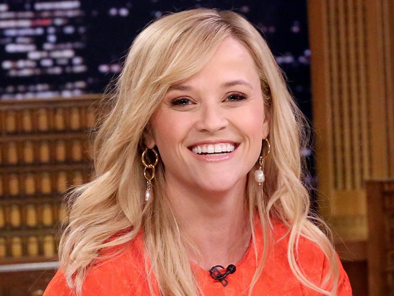 Celebrity Hair-Reese Witherspoon wearing an orange shirt
