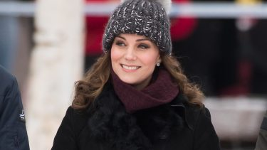 Kate Middleton Pieces feature image shows Kate wearing a pom-pom toque and a black jacket