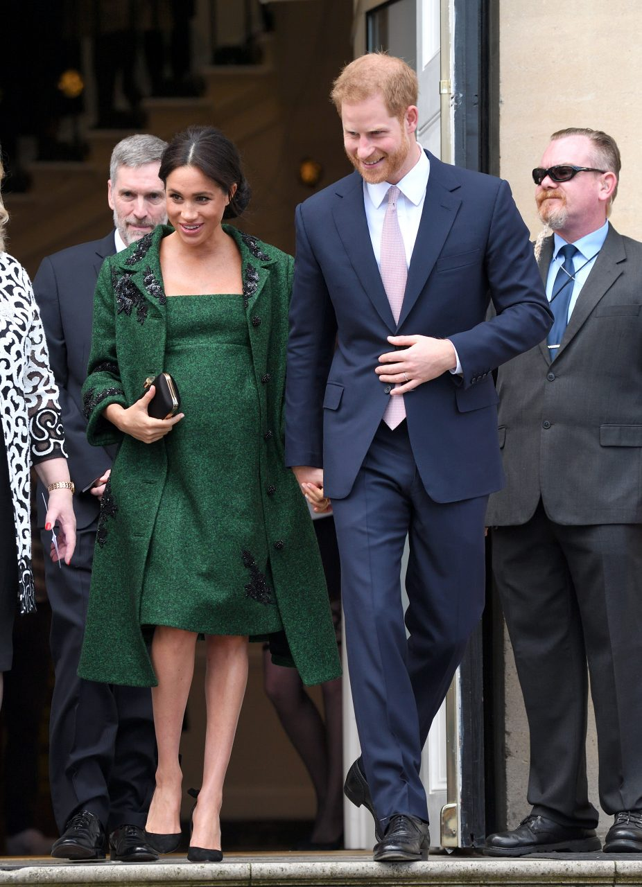 Meghan Markle and Prince Harry at Canada House. Markle wears a green, 50's style coat by Erdem.