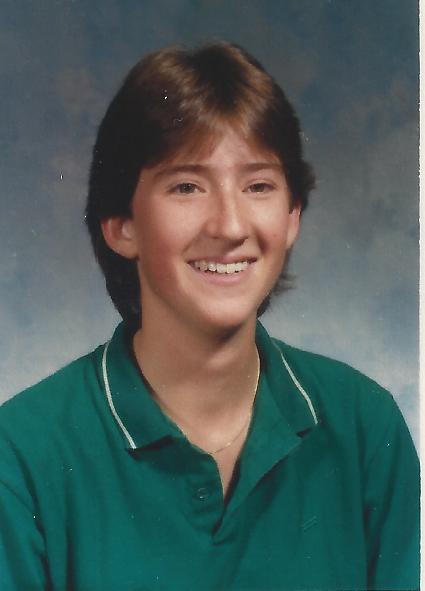 This One Looks Like A Boy Lorimer Schenher-high school photo of Lorimer Shenher wearing a green polo shirt