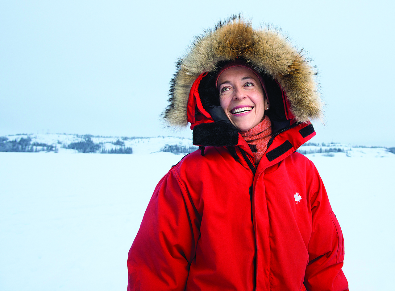 Courtney Howard in red parka against snow covered background — Courtney Howard climate change mental health