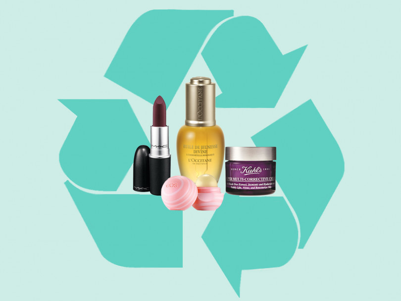 Beauty brands that recycle — M.A.C. lipstick, EOS lip balm, L'Occitan bottle, Kiehl's tub with recycling sign in background