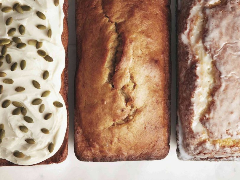 Carrot cake with cream cheese icing, banana bread and lemon loaf in a row