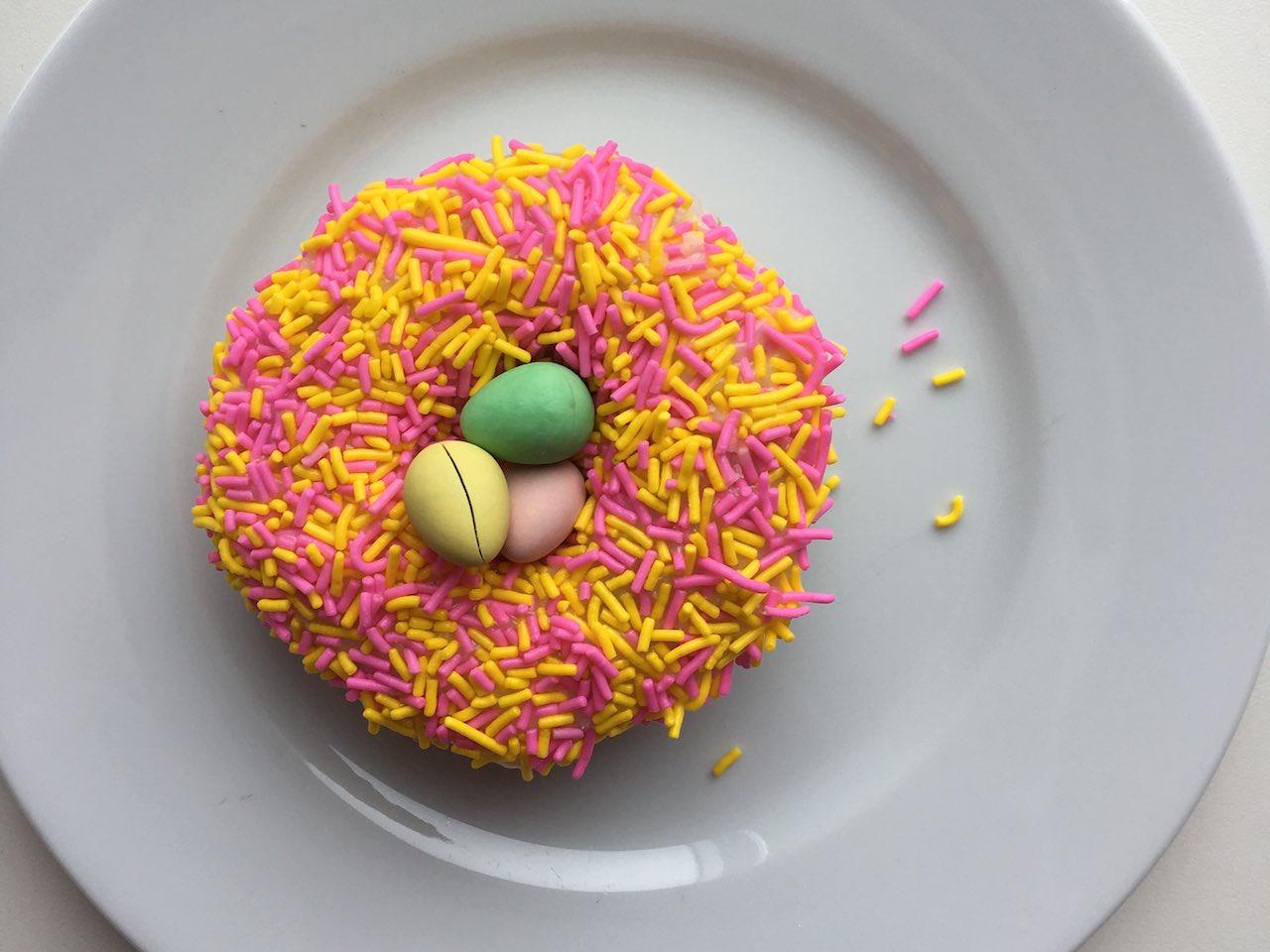 Tim Hortons Mini Eggs doughnut on white plate.