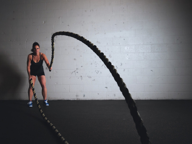F45 fitness craze-woman doing ropes in a gym