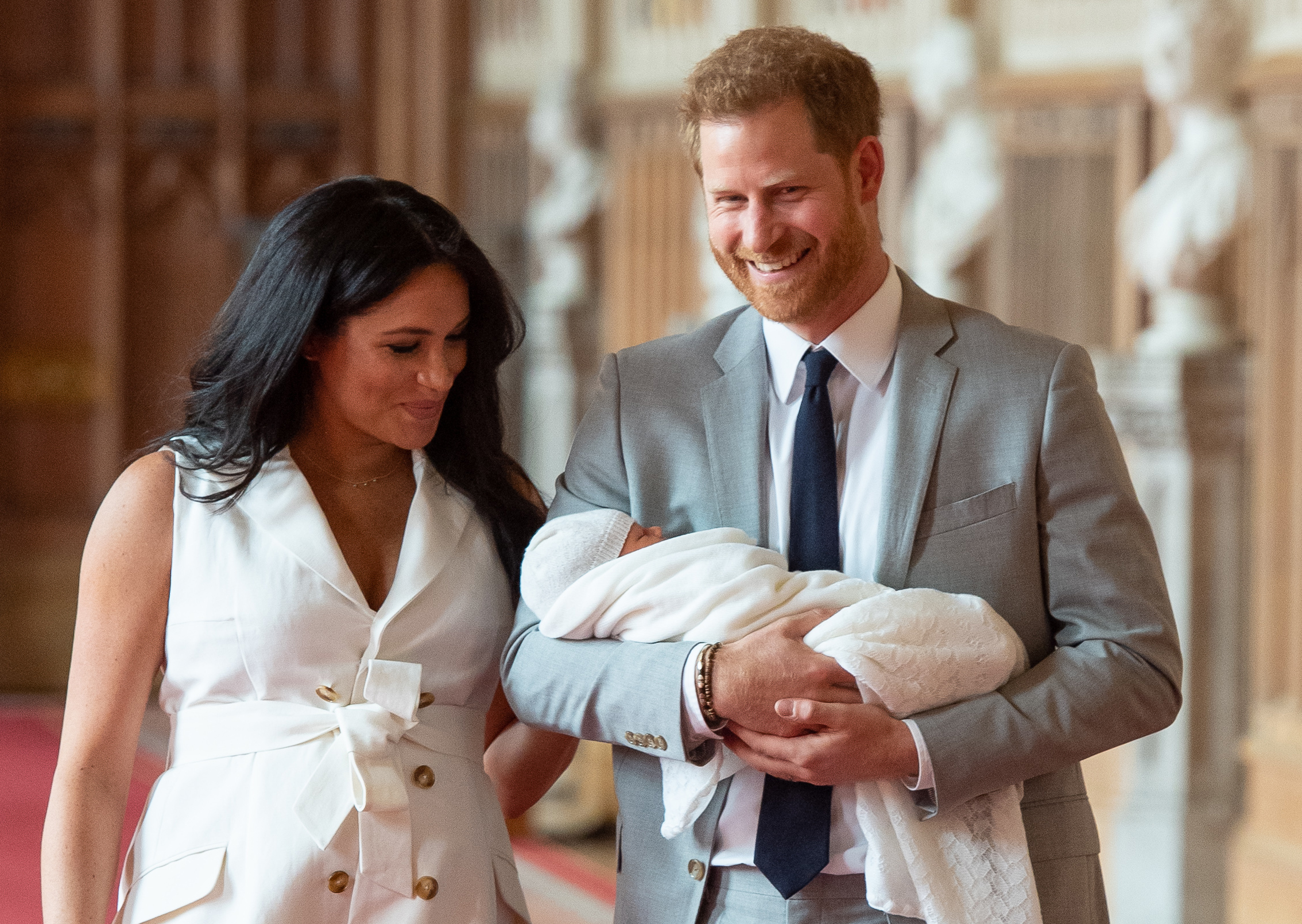 Prince Harry, and Meghan, Duchess of Sussex, pose for a photo with their newborn baby son
