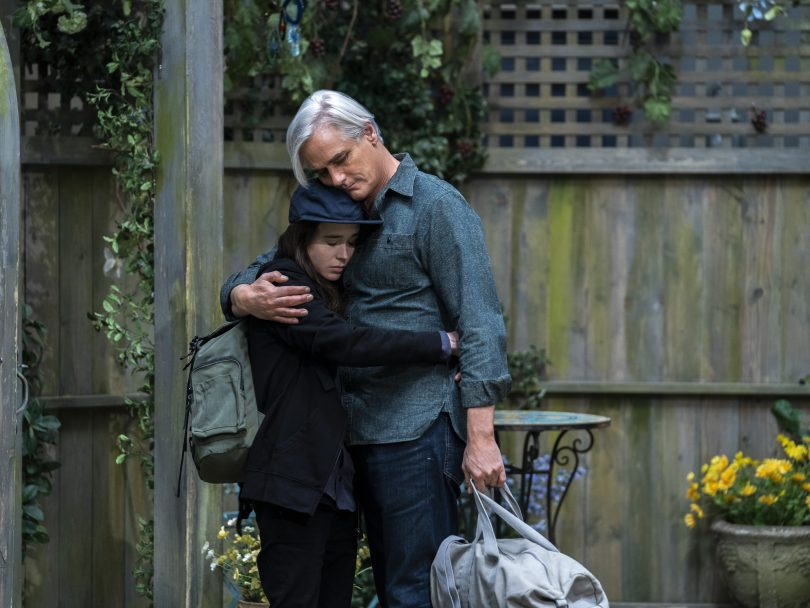 Paul Gross in the Netflix reboot of Tales of the City, embracing Ellen Page in a backyard.