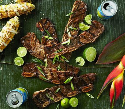 Filipino food-Overhead shot of Grilled Filipino Adobo Kalbi Ribs on a LEAFY GREEN background