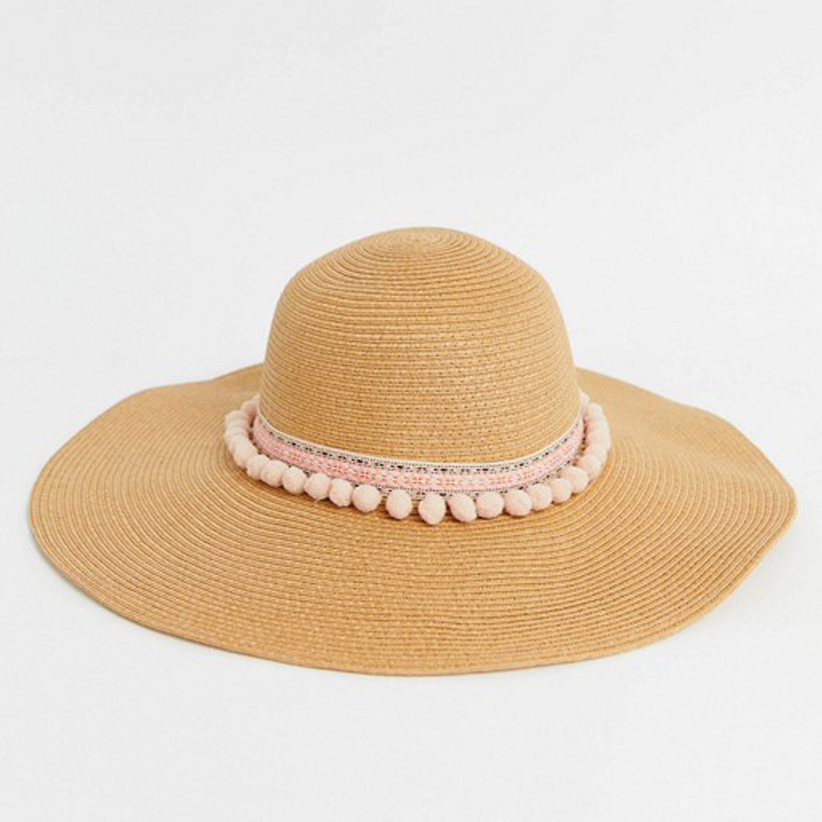Pom pom lined beach floppy hat from ASOS: on sale vacation ready beach essentials