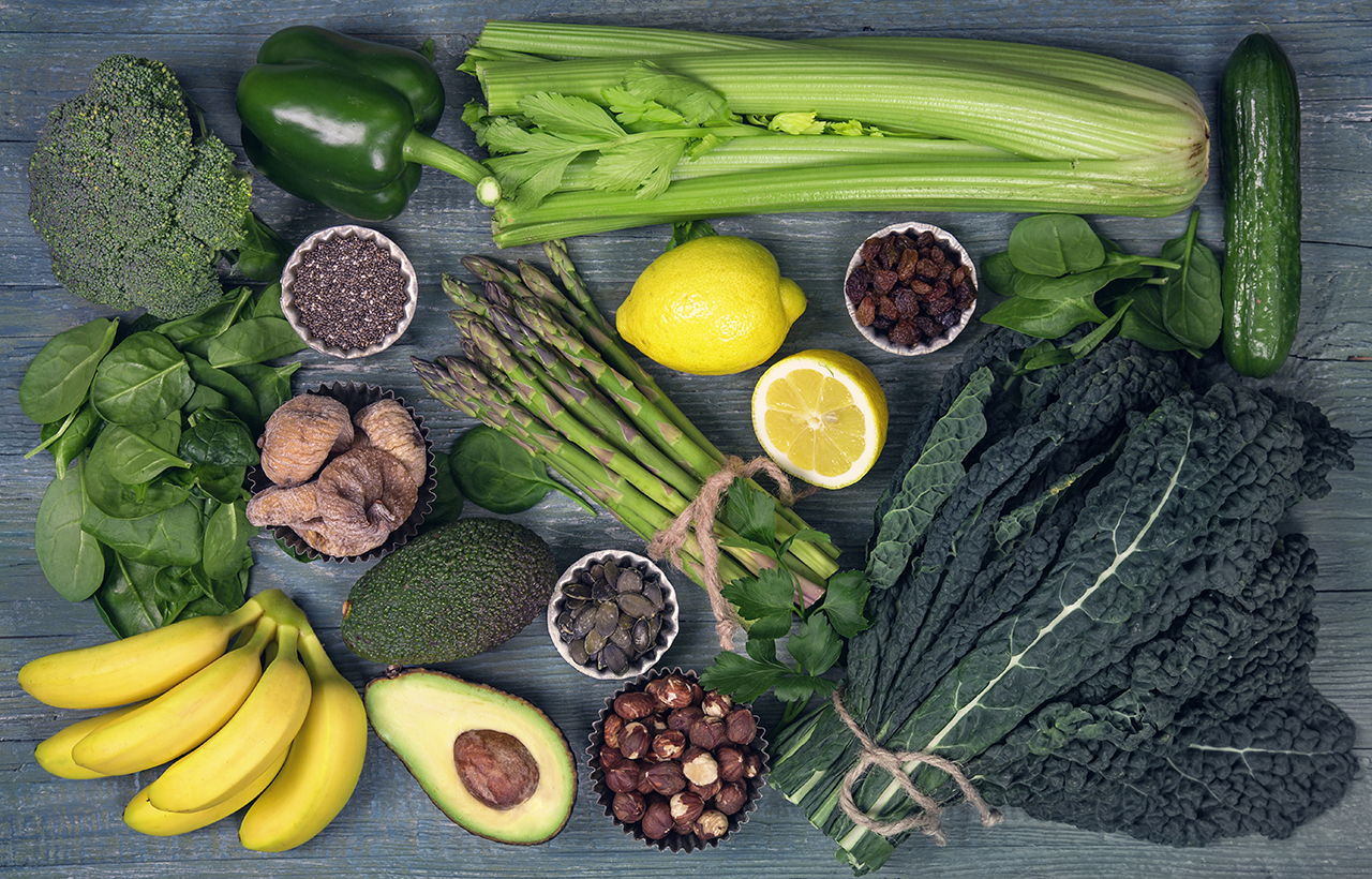 Alkaline foods above the wooden background—debunked: how to become more alkaline and less acidic