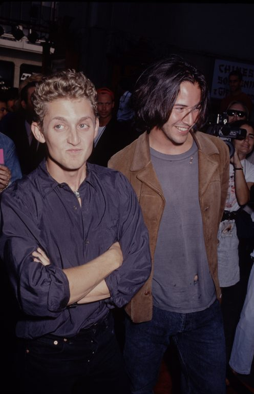 Keanu reeves crush: Alex Winter in blue button down and Keanu Reeves in old tshirt and brown leather jacket
