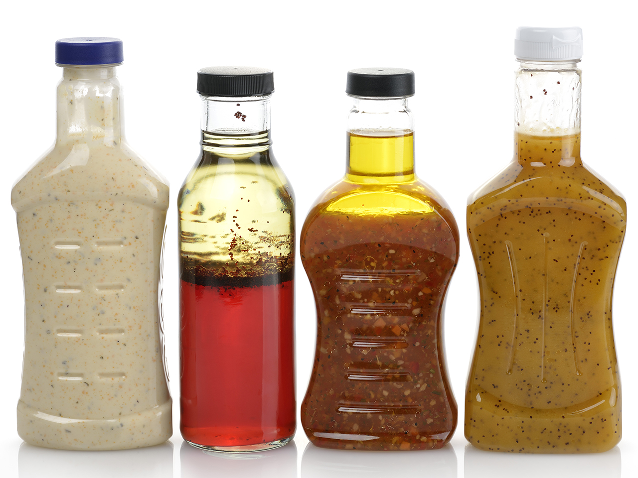 reuse single-use plastics: Assortment Of Four Salad Dressing Bottles without labels