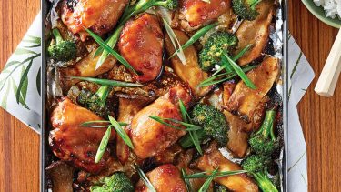 Glazed chicken thighs with miso sauce, roasted broccoli and mushrooms on a sheet pan