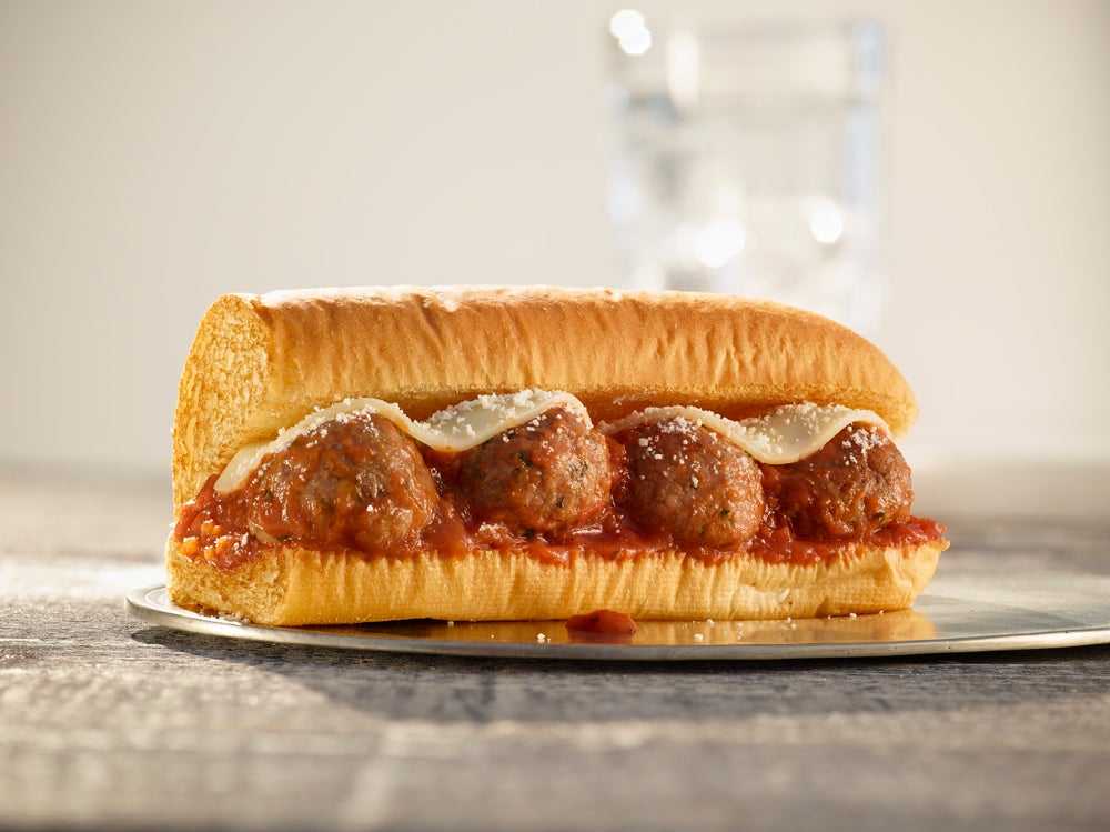 Picture of Subway Beyond Meat Meatball sub on a glass plate.