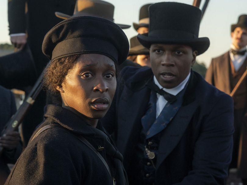 A woman dressed in pre civil-war era hat and cloak