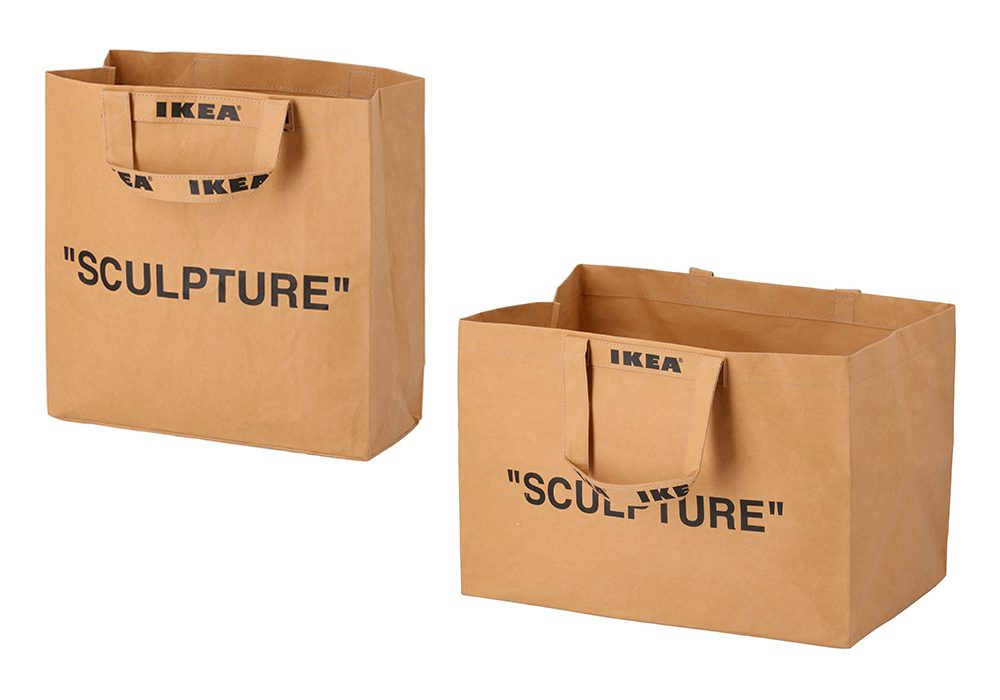 """Large and medium brown carrier bags with the word \""""Sculpture\"""" written in black font from the IKEA Virgil Abloh collection pictured on a white background."""