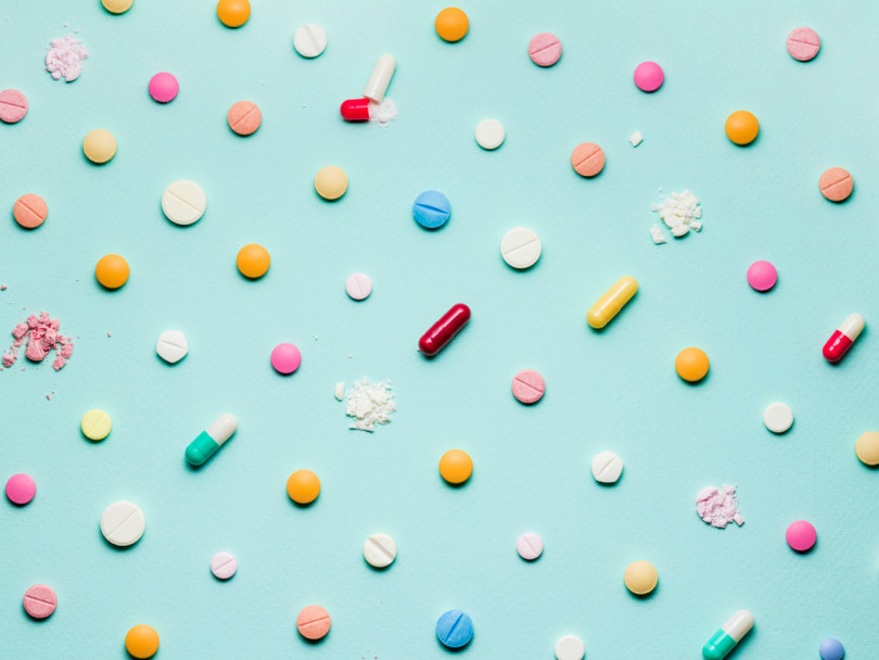 Pretty pills against a backdrop of blue