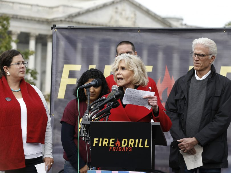 "Jane Fonda and Ted Danson speak during ""Fire Drill Friday"" in DC."