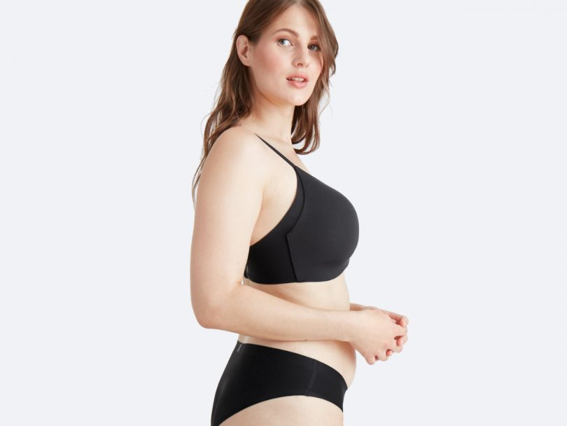 how to buy a bra online-a woman wears a full-coverage t-shirt bra and matching underwear in black.