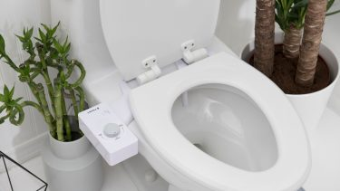 Tushy bidet hooked up to a white toilet