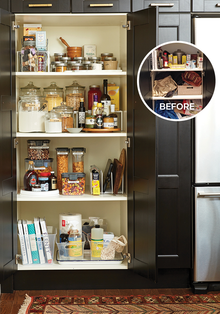 inside of a very organized double-door full-height pantry cupboard filled with dry and canned goods