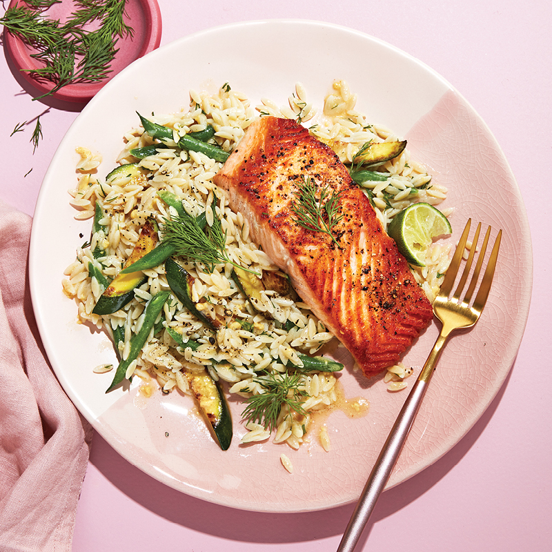 Salmon fillets with green beans and zucchini orzo