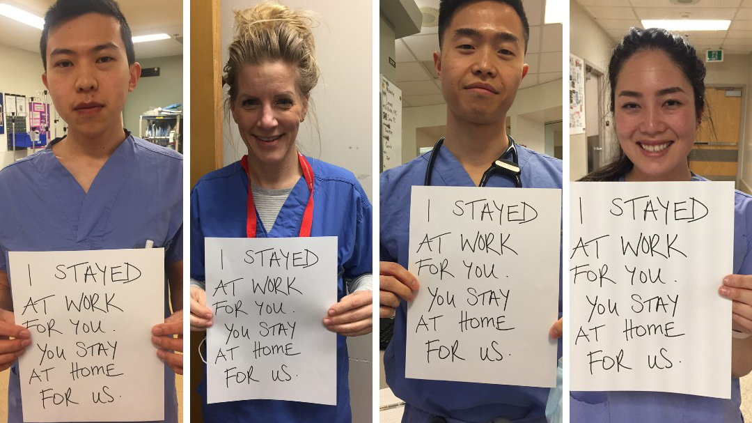 The Vancouver Coastal Health ER team holding signs encouraging people to stay home