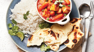 Paneer and carrot curry with rice and naan.