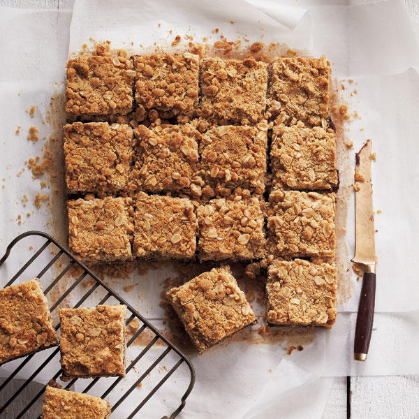 Old-fashioned date squares, cut on parchment.