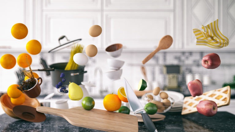 food flying around in a kitchen