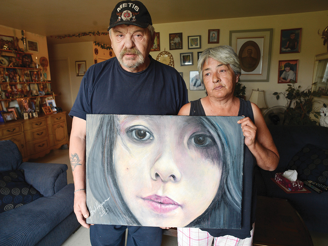 A photo of Joe and Thelma Favel holding an image of their niece Tina Fontaine, an Anishinaabe teenager who was murdered in Winnipeg in 2014. Her death galvanized national support for an inquiry into missing and murdered Indigenous women and girls.