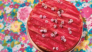 Rhubarb upside-down cake on a floral background