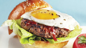 Beef burger served with an egg and steak sauce on brioche buns.