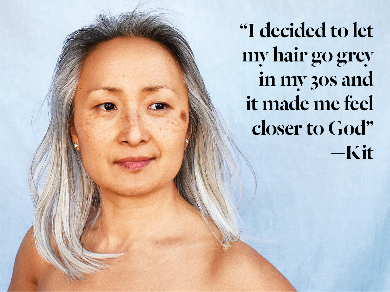 A photo of an Asian woman in her fifties with silver hair
