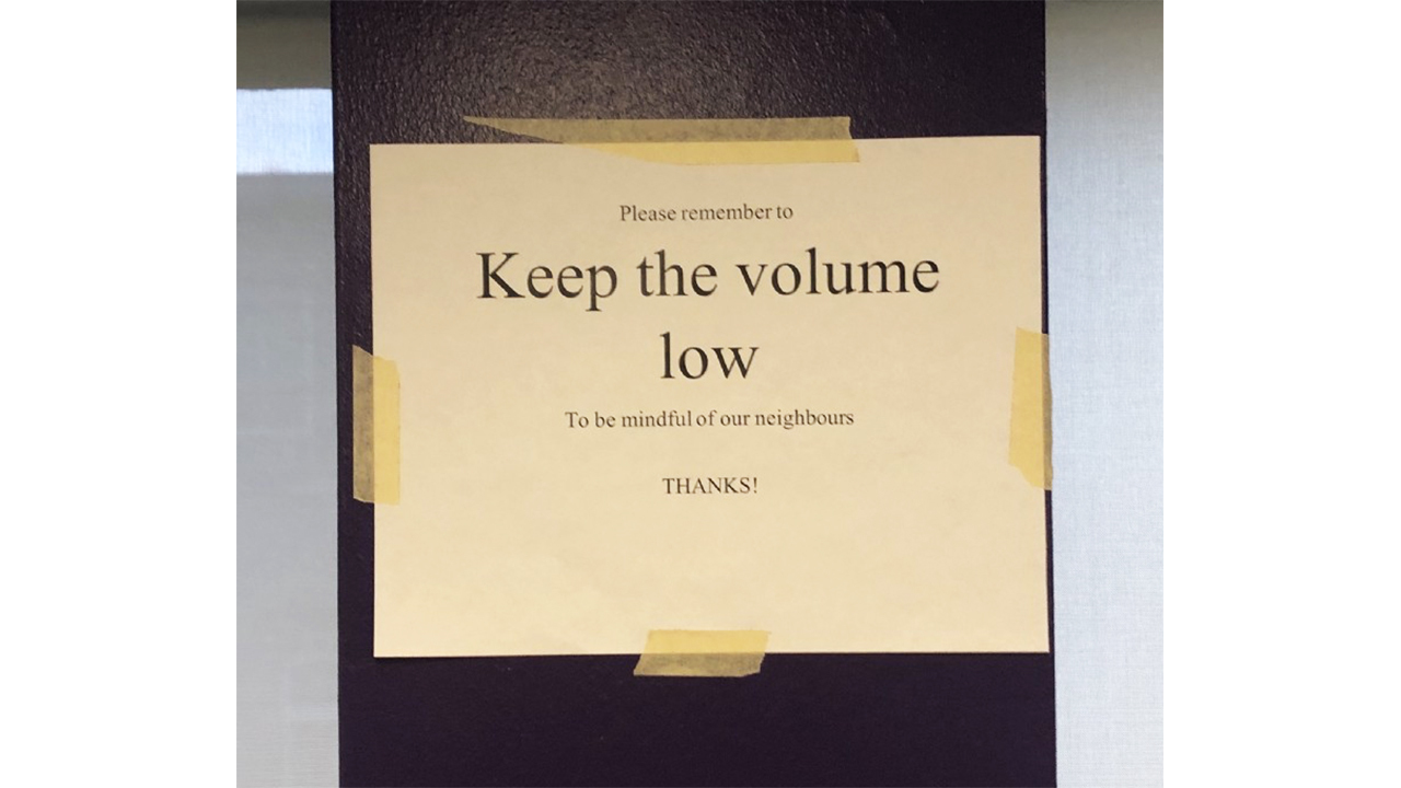 "A photo of a sign reading ""Keep the volume low."""
