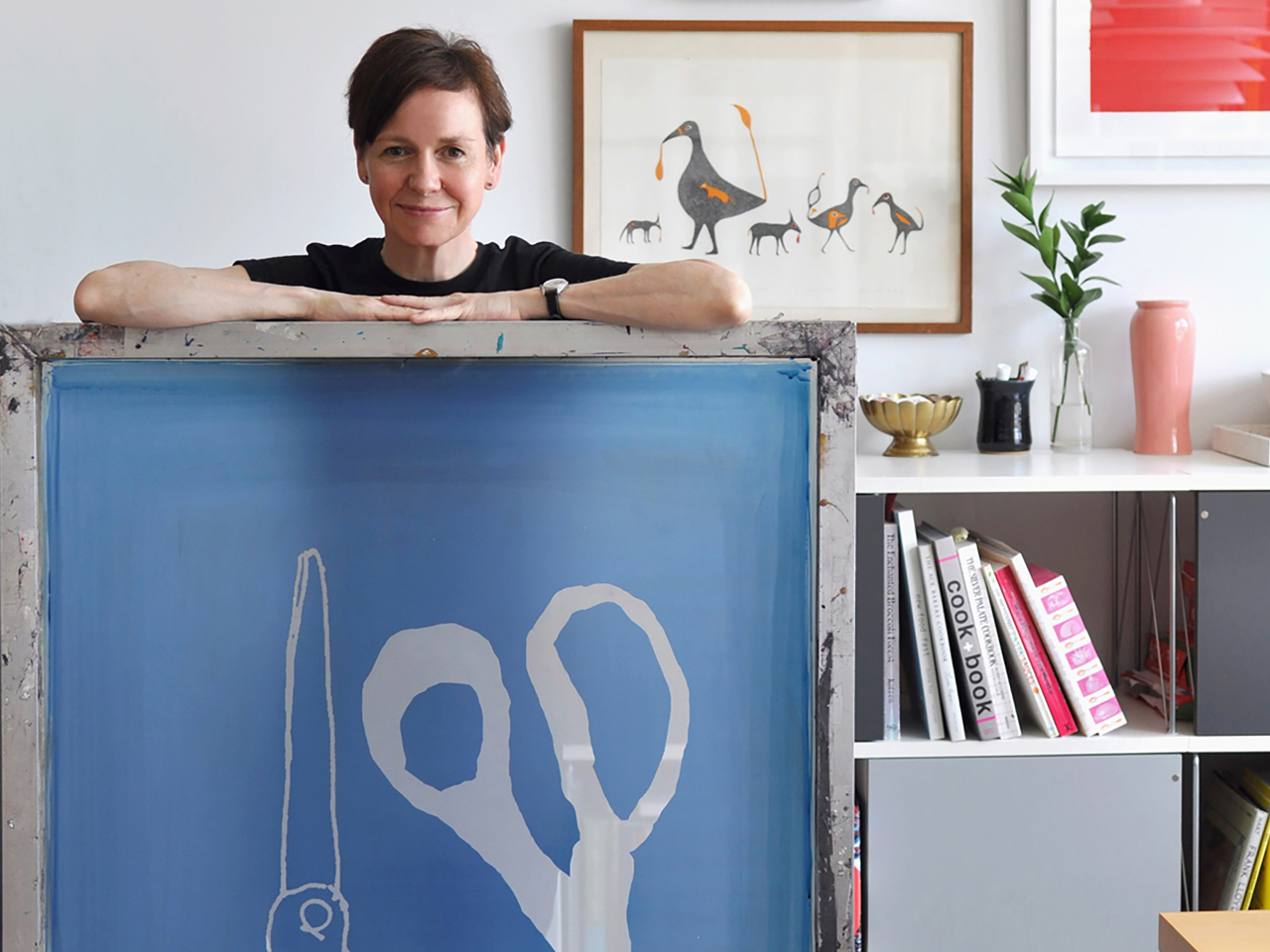 Canadian artist Alanna Cavanagh posing with several of her pieces to illustrate an article on female artists in Canada.