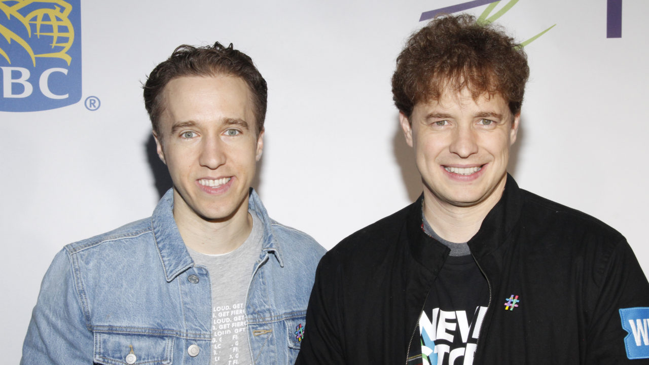 Craig Kielburger and Marc Kielburger at WE Day Toronto 2019 for a piece explaining the WE controversy and scandal