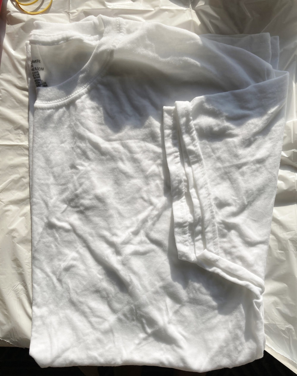 A folded white t-shirt for a piece on how to tie-dye at home