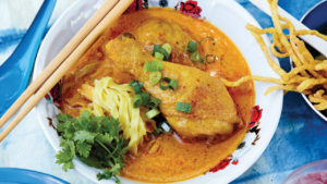 Chef Nuit Regular's Khao Soi Gai (chicken drumstick curry) with roasted chili oil and garlic oil