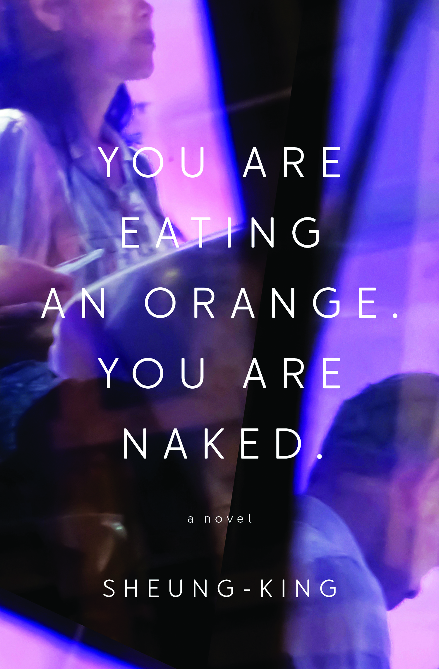 "The cover of the book ""You Are Eating An Orange. You Are Naked."""