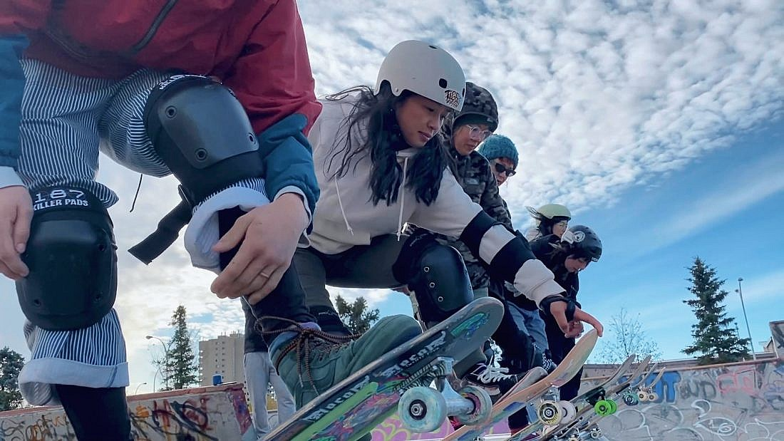 four women line up to skate a half tube